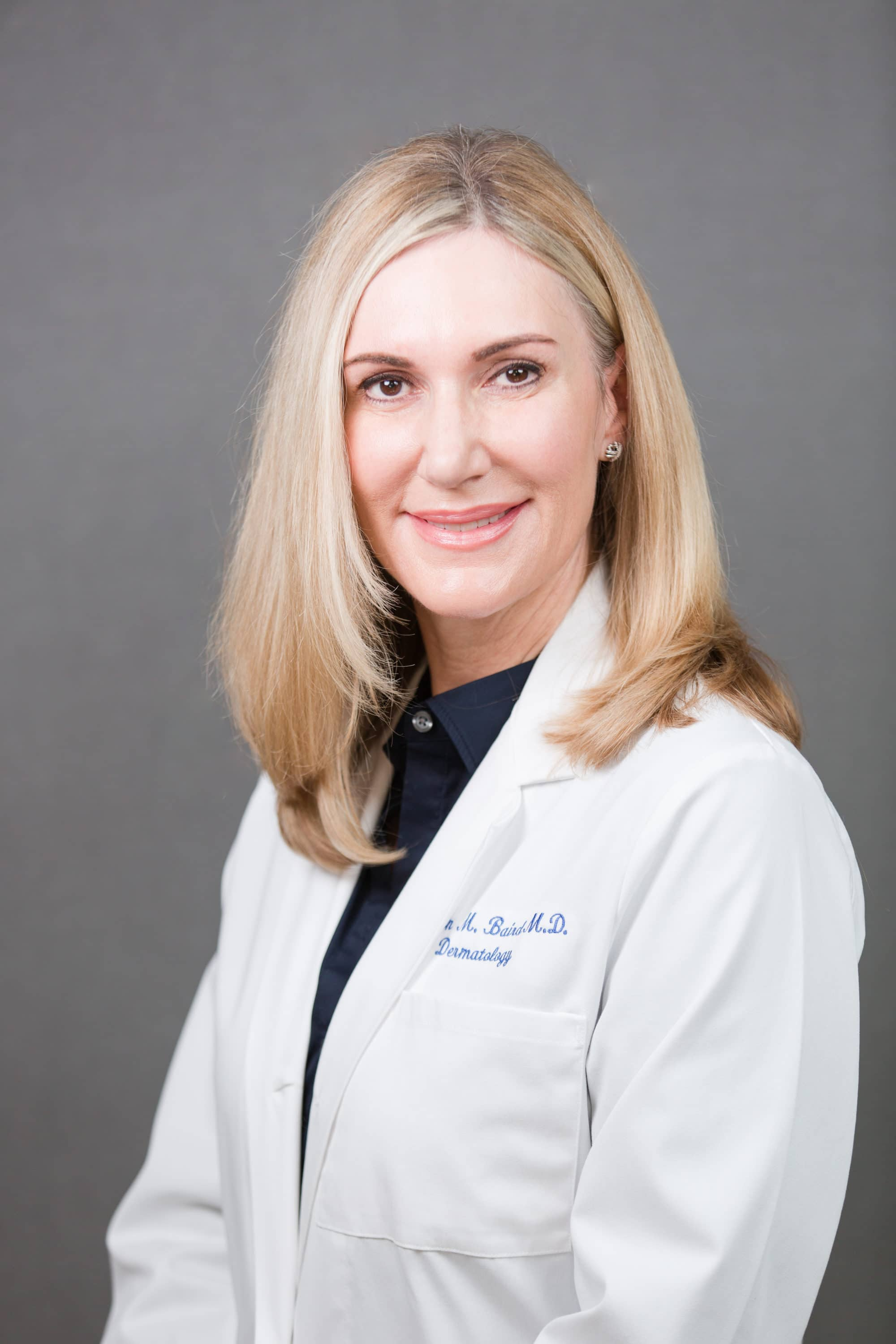 2019 dr. baird headshot white coat