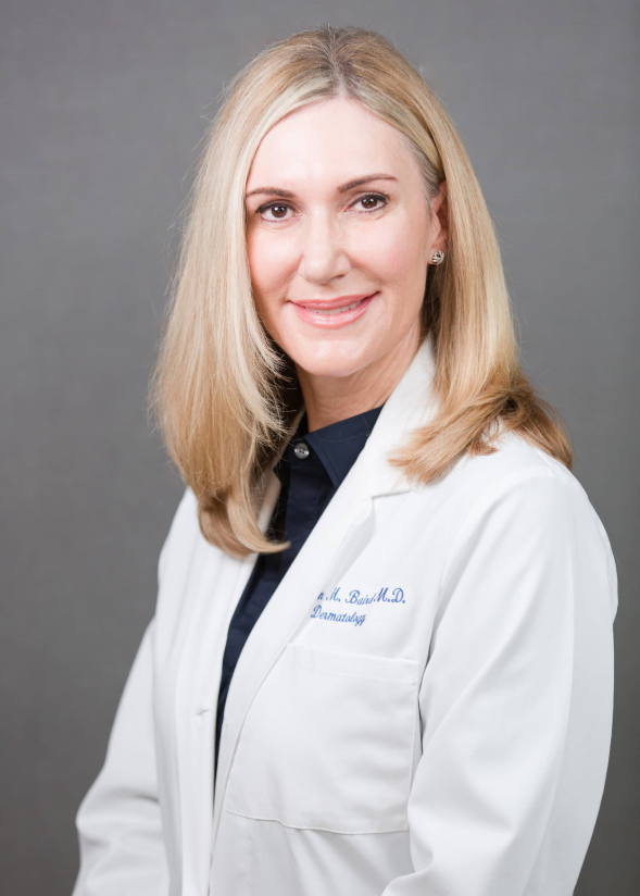 2019 dr. baird headshot white coat e1.jpg